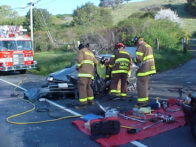 Kentfield Firefighters perform veicle accident rescue and extrication, Removing drivers door